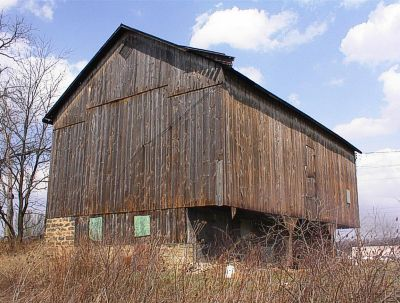 Cantilevered two story barn with oak timbers.